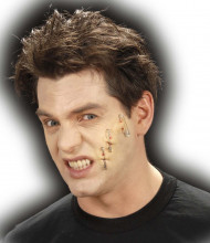 Herida hecha con imperdibles Halloween