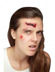 Herida falsa con puntos de sutura