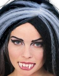 Dientes de vampiro con pegamento dental